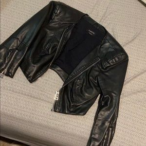 Bebe cropped, half sleeve leather jacket size xs